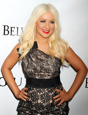 Christina Aguilera paired her embroidered dress with matching dark nail polish.