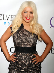Christina Aguilera rocked center part curls in a platinum shade of blond.
