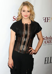 Dianna Agron styled her hair in a swept swept curls that perfectly framed her face.