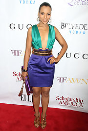 Kerry Washington added shine to her vibrant Gucci dress with metallic gold Malika sandals with spiked heels.