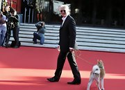 There's just nothing wrong with a handsome leading man wearing a suit and walking a dog on the red carpet in Rome.
