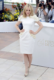 Rachel McAdams complemented her ladylike white rosette-adorned shift with nude leather platform peep-toes.