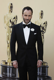 Tom showed off his tapered haircut while hitting the Academy Awards.