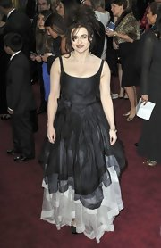 Helena Bonham Carter showed off her quirky style with a black and white silk taffeta tiered gown at the 2013 Oscars.