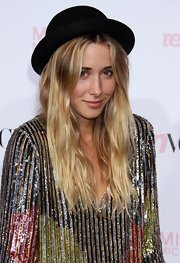 Gillian topped off her sparkling sequin top with a cute bowler hat.
