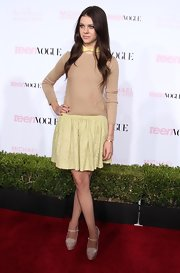Nicola Peltz added a girly touch to her ensemble at the Teen Vogue Young Hollywood party with a yellow lace mini skirt.