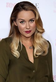 Lauren Conrad puckers up in deep berry lipstick. The retro shade complements her wingtipped liner.