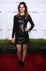 Gia paired her peep toe ankle boots with a leather panel embellished dress.