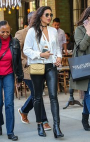 Shay Mitchell flashed her bra in a plunging white wrap top while out and about in New York City.