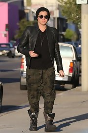Adam Lambert rocked the punk look with this sleek leather jacket paired with camo pants.