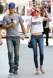 Behati's white bat tee matched her fiance, Adam's, casual look. Too cute!