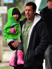 Sunny is darling in a bright green and pink rain coat.