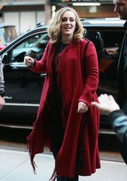 Adele steps out in NYC in a red duster with fringe detailing on the edges