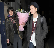Agyness Deyn topped off her eclectic London look with a navy newsboy cap.