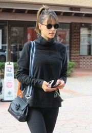 Alessandra Ambrosio rocked all black, from her shades down to her leggings, while headed to a workout.