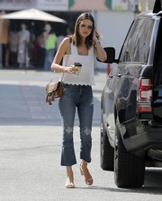 Alessandra Ambrosio completed her breezy outfit with nude block-heeled sandals.