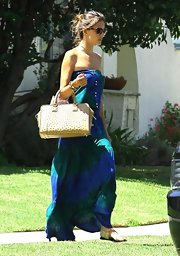 Alessandra paired her printed maxi dress with a ostrich tote bag.