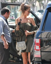 Alessandra Ambrosio paired a Chloe tasseled shoulder bag with an off-the-shoulder dress for a boho look while out in West Hollywood.