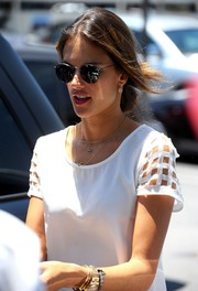 Alessandra Ambrosio looked perfectly styled for a summer day in round sunnies and a lightweight blouse.