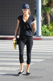 Alessandra Ambrosio teamed black capri leggings with an old tee for a day out in LA.