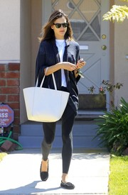 Alessandra Ambrosio styled a plain white shirt with a draped navy cardigan by Michael Lauren for a day out in Brentwood.