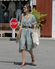 Alessandra Ambrosio completed her casual-chic look with brown ankle-strap wedges.