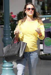 Alessandra Ambrosio gave her Birkin a rest, instead carrying an equally luxe black croc tote.