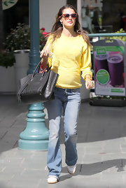 Alessandra Ambrosio kept things simple and Spring appropriate in a sunny yellow top and light denim flares.