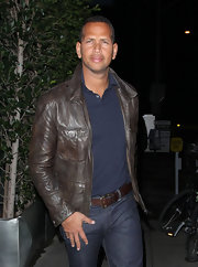 Alex Rodriguez tempered a preppy polo with a distressed leather jacket.