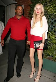 Alfonso Ribeiro looked handsome when going out for a Valentine's Dinner in a red half-zip sweater.