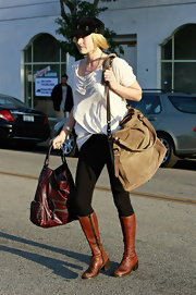 Ali's side-zip, brown, leather, knee high boots have a small heel and rounded toe. These are a hot, casual style for fall.