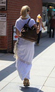 Alice Eve went out on a juice run carrying a stylish brown satchel.
