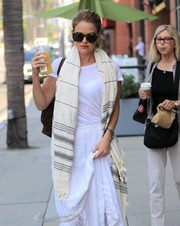 Alice Eve styled her summer whites with a striped scarf for a day out in Beverly Hills.