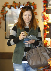 Alyson stopped by a local Starbucks where she showed off a luxe leather handbag.
