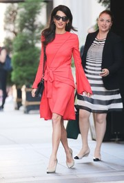 Amal Clooney paired her dress with simple nude pumps by Paul Andrew.