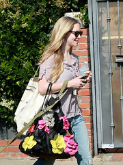Amanda Seyfried showed off her flower embellished tote bag while hitting the gym in West Hollywood.