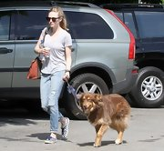 Amanda Seyfried chose a light-wash pair of ripped jeans for her relaxed look while out walking her dog.
