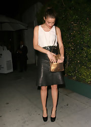 Amber Heard added a shimmering pop to her minimal black and white look with this sparkly bronze shoulder bag.