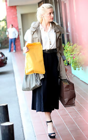 Amber Heard paired her chic midi skirt with black platform sandals.