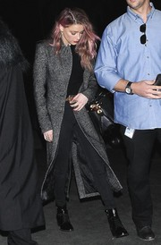 Amber Heard kept a low profile in a gray Smythe tweed coat and black jeans while headed to a Halloween party.