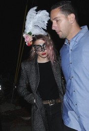 Amber Heard was spotted on her way to a Halloween party wearing a feather and flower fascinator.