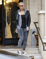 Amber wears gray washed jeggings with a leather jacket and zip up hoodie.