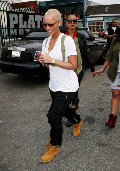 Amber Rose donned casual tan lace up boots while shopping for a car.
