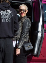 Amber Rose headed to a Thanksgiving party carrying a classic quilted bag by Chanel.