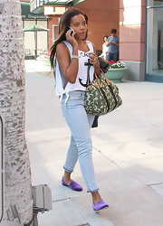 Angela Simmons looked summery in an anchor muscle tank and pale skinny jeans.