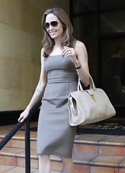 Angelina Jolie toted this oversize ecru bag with her classic sheath dress.