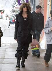 Angelina Jolie teamed her jacket with a pair of black ski pants.