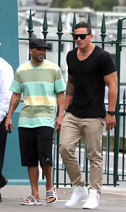 Sonny Bill Williams took a stroll in Sydney wearing a tight black shirt and chinos.
