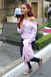 Ariana Grande channeled flash dance in this pink off-the-shoulder sweater.