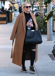 Ashlee Simpson stepped out for a lunch date wearing a bulky tan wool coat.